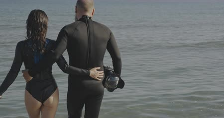 barbatana : Freediver couple walking to the sea. Filmed on cinema camera, 12 bit coolor