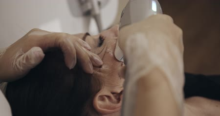 совершенство : Closeup of non-surgical face lifting. Beautician and a woman patient. Filmed on cinema camera, 12 bit color