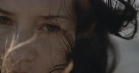 szövetek : Very close dramatic female portrait. Sad eyes and windy air, Filmed on cinema camera, 12 bit color