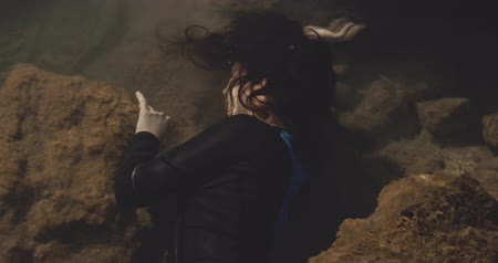 sós : Woman lying underwater, Dramatic concept, filmed on cinematic camera, 12 bit color