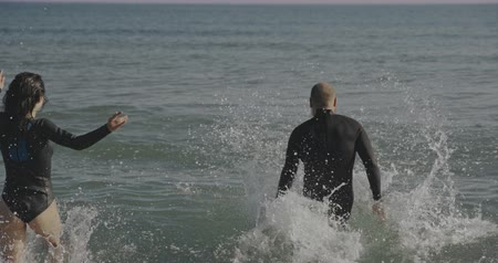 barbatana : Two people in love in wetsuites. Filmed on cinema camera, 12 bit coolor Stock Footage