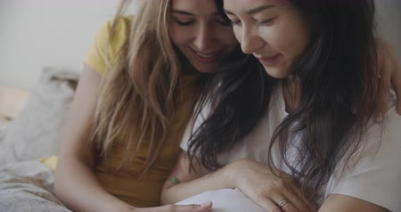 two gender : Lesbian couple family waiting a baby. Lgbt, homosexual, pride, bisexual, gay lovewins equality, loveislove friendship, concept. Filmed on RED, 12 bit color, 4k
