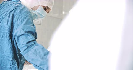 liposukcja : Surgeons in operating theatre. Medicine, surgery, health care concept. Filmed on RED 4k, 10 bit color space