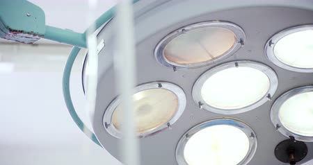 surgical light : A surgery lamp in operation room. Medicine, surgery, health care concept. Filmed on RED 4k, 10 bit color space