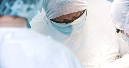 aseptic : A group of surgeons, operating room. Medicine, surgery, health care concept. Filmed on RED 4k, 10 bit color space