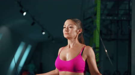 broca : POrtrait of Athletic Beautiful Woman Exercises with Jump Rope in a Gym. Sport, fitness, lifestyle, beauty concept. Filmed on cinemacamera.