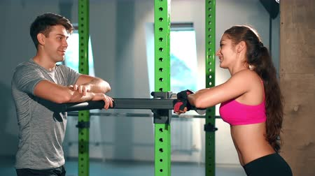broca : Couple of friends chatting in gym. Sport, fitness, lifestyle, beauty concept. Filmed on cinemacamera.