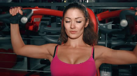 broca : Woman pumping muscles in gym. Sport, fitness, lifestyle, beauty concept. Filmed on cinemacamera.
