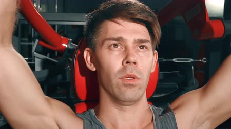 broca : Athletic Man pumping muscles in gym. Sport, fitness, lifestyle, beauty concept. Filmed on cinemacamera. Stock Footage