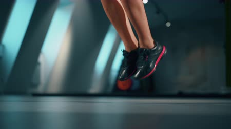 broca : Athletic Beautiful female feet Exercises with Jump Rope in a Gym. Sport, fitness, lifestyle, beauty concept. Filmed on cinemacamera.