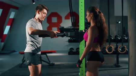 broca : Couple of friends training in gym together. Sport, fitness, lifestyle, beauty concept. Filmed on cinemacamera. Stock Footage