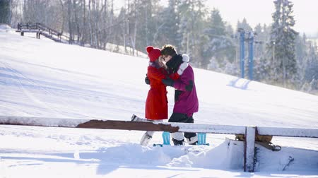girfriend : Coulple dating in mountain ski resort at sunny day. Winter, sport, holidays, relationship, love, xmas, lifestyle concept. Filmed on cinema camera, 10 bit color space. Stock Footage