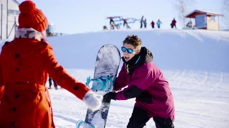 girfriend : Happy coulple dating in mountain ski resort at sunny day. Winter, sport, holidays, relationship, love, xmas, lifestyle concept. Filmed on cinema camera, 10 bit color space.