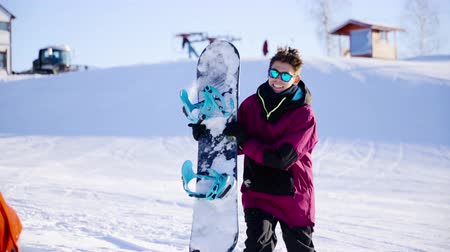 girfriend : Young coulple dating in mountain ski resort at sunny day. Winter, sport, holidays, relationship, love, xmas, lifestyle concept. Filmed on cinema camera, 10 bit color space.