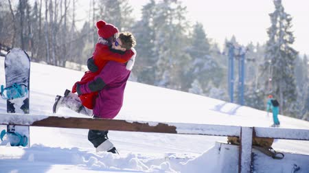 girfriend : Multicultural coulple dating in mountain ski resort at sunny day. Winter, sport, holidays, relationship, love, xmas, lifestyle concept. Filmed on cinema camera, 10 bit color space.
