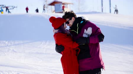 girfriend : Coulple in love in mountain ski resort at sunny day. Winter, sport, holidays, relationship, love, xmas, lifestyle concept. Filmed on cinema camera, 10 bit color space. Stock Footage