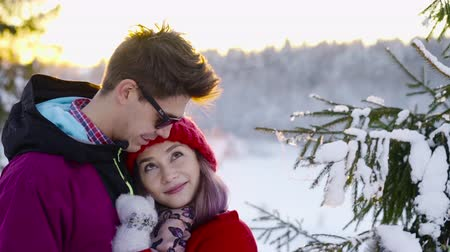 girfriend : Happy coulple in love at sunny winter day. Winter, sport, holidays, relationship, love, xmas, lifestyle concept. Filmed on cinema camera, 10 bit color space.