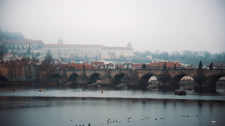 most : Panoramic view of foggy Pague Charles Bridge. Travel, city, Europe concept. Filmed on RED camera, 10 bit clolor