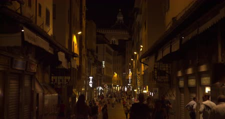 szórakoztatás : Firenze, Tuscany Italy - August 30, 2020 Florence. Night street with crowd walking through it. Florence city. Travel, lifestyle, urban concept. Filmed on RED 4k, 12 bit color