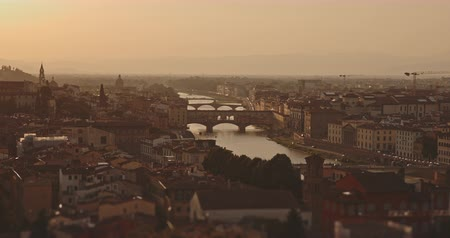 maria : Panoramic view of Florence city at sunset with mountains in background. Travel, lifestyle, urban concept. Filmed on RED 4k, 12 bit color