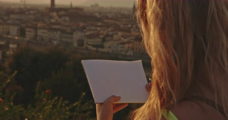 maria : Painter girl drawing from nature at sunset in Florence city. Travel, art, tourism, lifestyle, urban concept. Filmed on RED 4k, 12 bit color