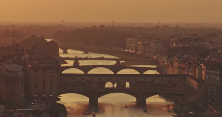 skyline firenze : Panoramic view of Florence bridge at sunset with mountains in background. Travel, lifestyle, urban concept. Filmed on RED 4k, 12 bit color Filmati Stock