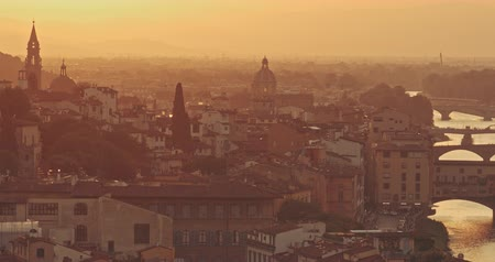 maria : Panoramic view of golden sunset of Florence with silhouettes of mountains in background. Travel, lifestyle, urban concept. Filmed on RED 4k, 12 bit color