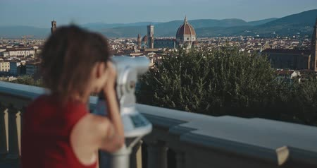 maria : Female tourist looking at Florence city through binoculars afrom the viewpoint . Travel, tourism, lifestyle, urban concept. Filmed on RED 4k, 12 bit color Stock Footage