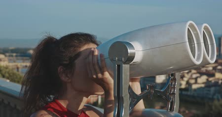 maria : Female tourist observing Florence city through binoculars afrom the viewpoint . Travel, tourism, lifestyle, urban concept. Filmed on RED 4k, 12 bit color Stock Footage