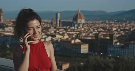 palazzo : Woman talking on phone on the background of Italy. Copy space. Travel, tourism, communication, buisness, commercial, lifestyle, urban concept. Filmed on RED 4k, 12 bit color