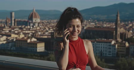 palazzo : Asian woman talking on phone on the background of Italy. Copy space. Travel, tourism, communication, buisness, commercial, lifestyle, urban concept. Filmed on RED 4k, 12 bit color Stock Footage