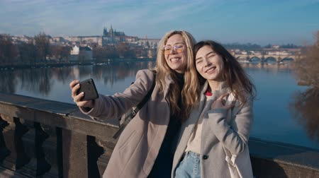 fama : Female friends taking selfe in Prague. Travel, friendship, youth, millenial, blogger, fame social media concept. Filmed on REd 4k, 10 bit color