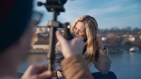 istantanea : Travel blogger girl creating content in Prague. Travel, blogger, fame social media concept. Filmed on REd 4k, 10 bit color