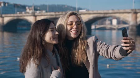 fama : Two travel blogger friends recordng vlog in Prague. Travel, blogger, fame social media concept. Filmed on REd 4k, 10 bit color