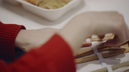 biodegradable : Woman using her own wooden cutlery in fast food place. Rejection of plastic. Ecological, recycle concept. Filmed on RED 4K, 10 bit color.