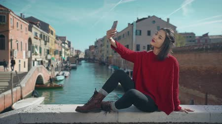 venedik : Asian woman in Venice, taking self-portrait photo on vacation travel in Italy. Smiling happy mixed race woman outdoors.
