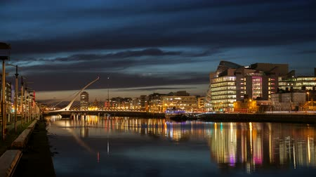 capital cities : time laps video of the City centre and river Liffey with Samuel Beckett Bridge during sunset. Dublin, Ireland