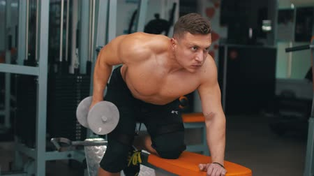 body building : trainer pumps the muscles of the back Stock Footage