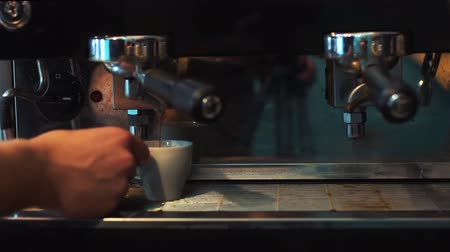 brew coffee : Preparing cups of espresso at a busy coffee shop Stock Footage