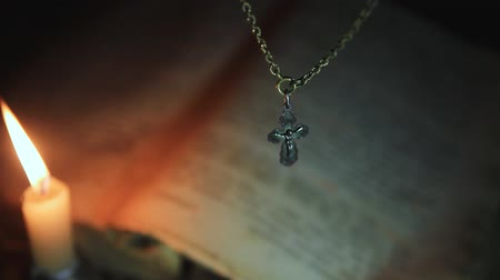 holy book : the cross on the chain above the psalter Stock Footage