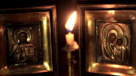 iconography : put out a candle in front of the icons of Jesus and the Mother of God