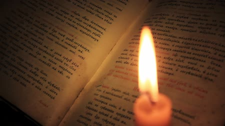 divinity : Old book and candle Stock Footage