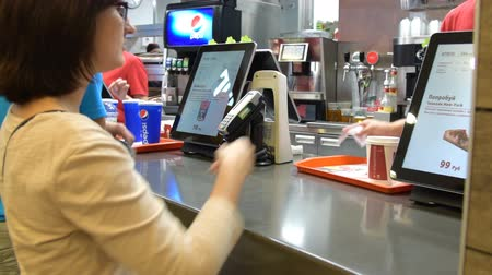 meal : Woman paying for the order in KFC