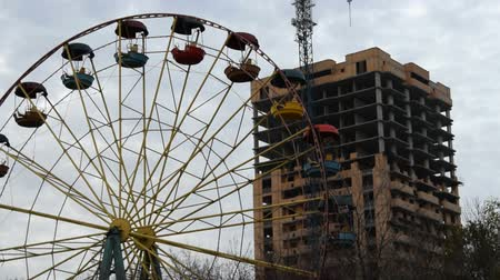 dismay : Old Ferris wheel and unfinished construction Stock Footage
