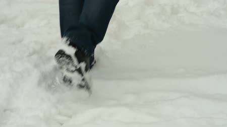 deep snow : Man feet walking on fresh fallen deep snow Stock Footage
