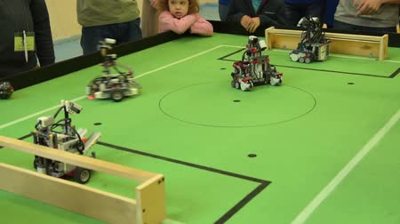 playfield : NOVOSIBIRSK, RUSSIA - APRIL 30, 2017: Robotics football competition. Robots made by schooldchildren and students competing Stock Footage
