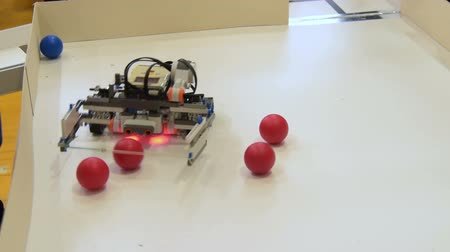 Robot collecting balls. Demonstration of school project in robotics
