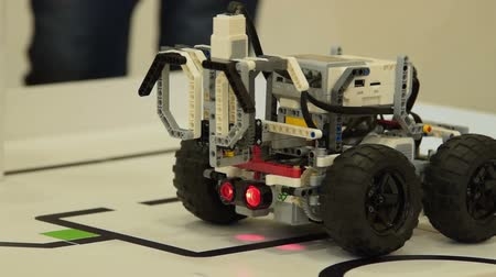 Close-up shot of testing a robot on the line. School project in robotics