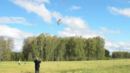 grandad : Family flying kites in the woods. Outdoor leisure and activities
