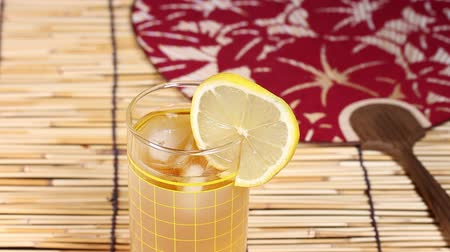 bamboo curtain : Glass of ice tea and japanese fan